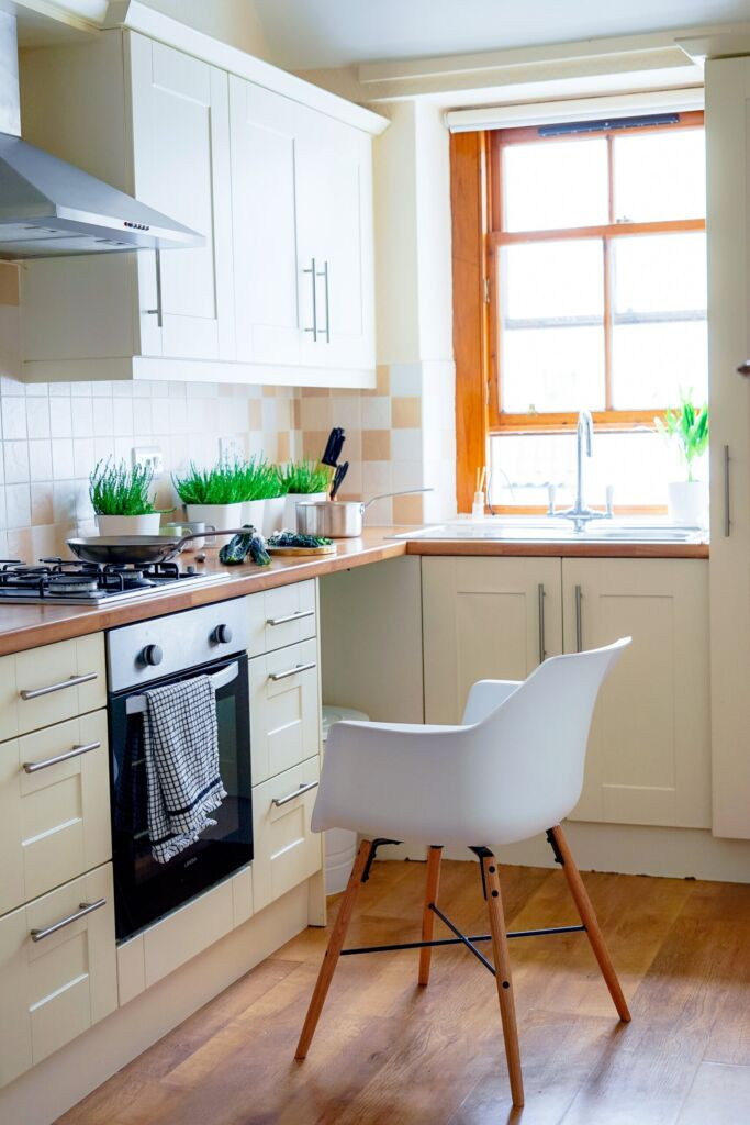 kitchen with white chair in front of stove