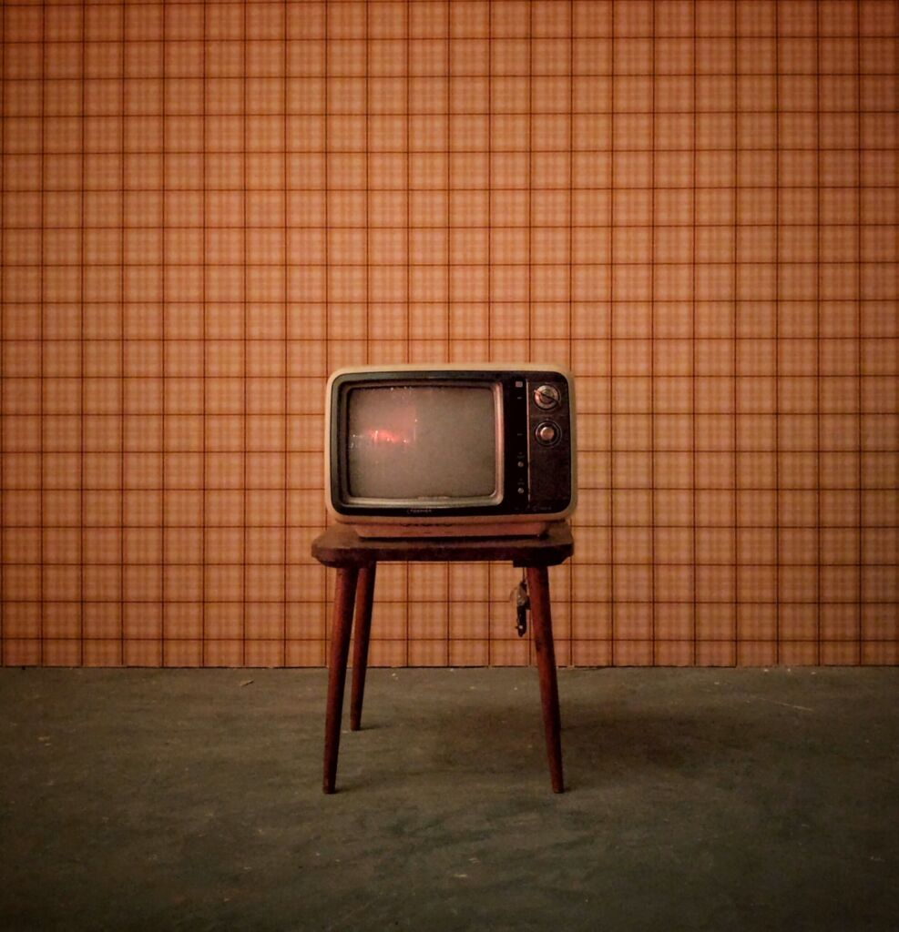 a stool with old tv sitting on it