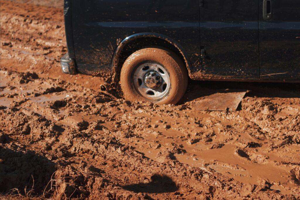 car wheel stuck in mud