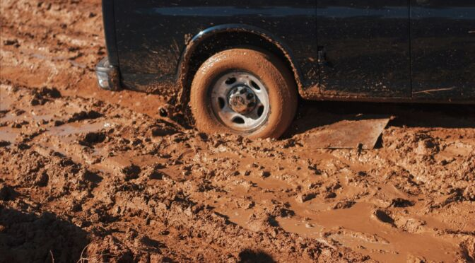 car wheel stuck in mud