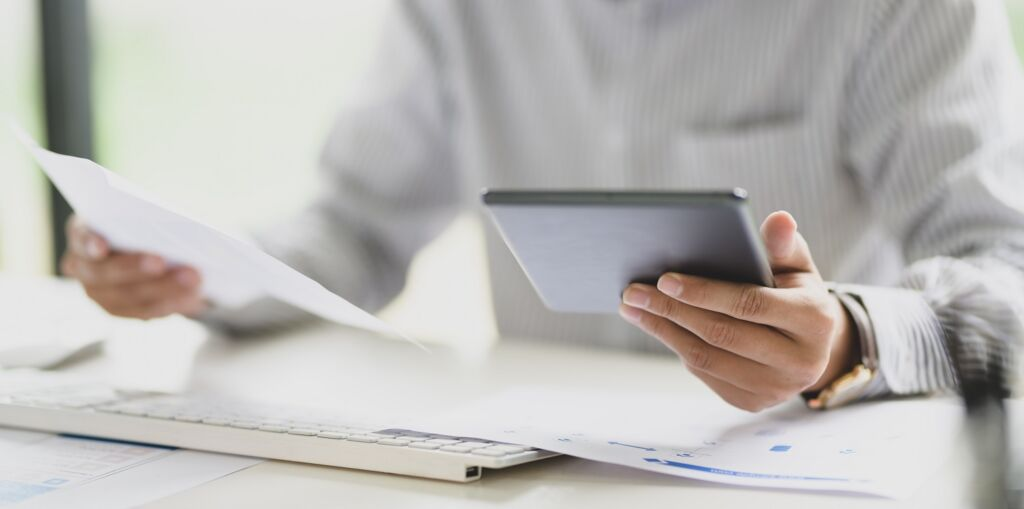 person holding tablet computer