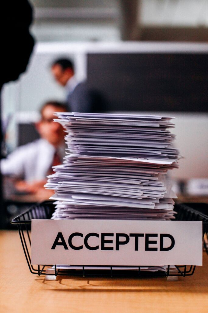 pile of papers with label accepted