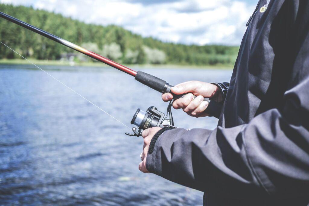 man holding fishing bait