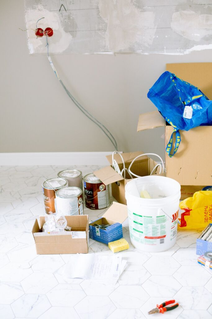 containers of paint and other equipment for repair
