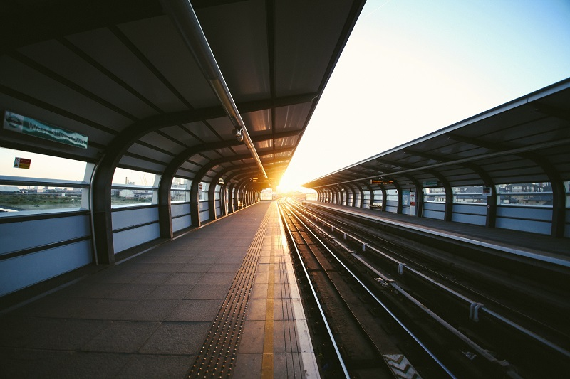sunset on a train station