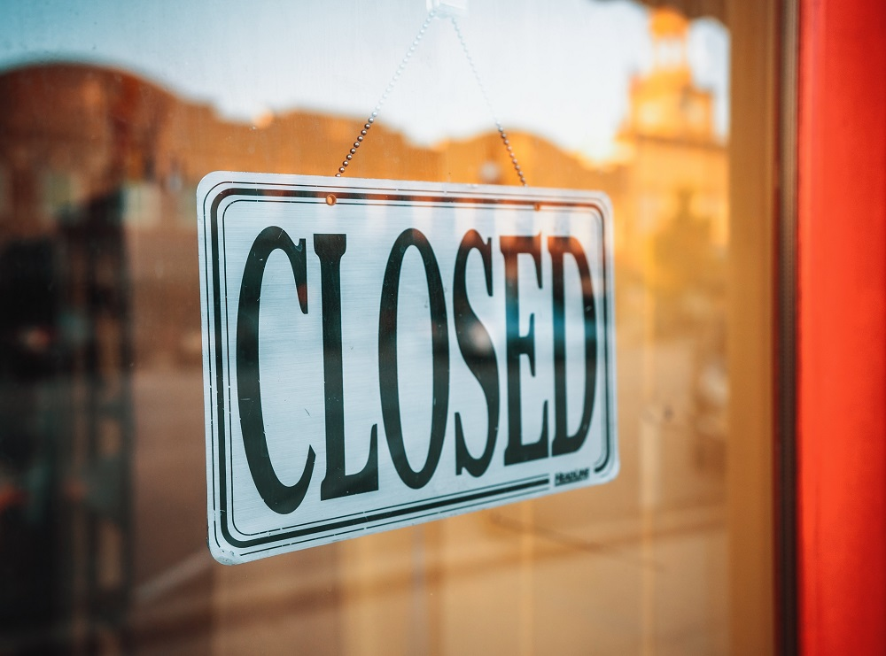 Closed signage hanging on glass door